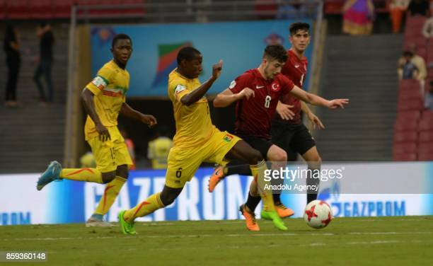 Kerem Atakan Kesgin of Turkey is in action against Mohamed Camara of Mali during the ceremony within a 2017 FIFA U17 World Cup football match between...