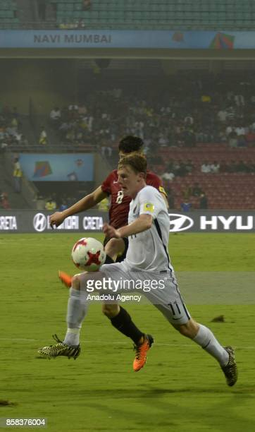 Kerem Atakan Kesgin of Turkey U17 in action against Matthew Conroy of New Zealand U17 during the FIFA U17 World Cup India 2017 football match between...