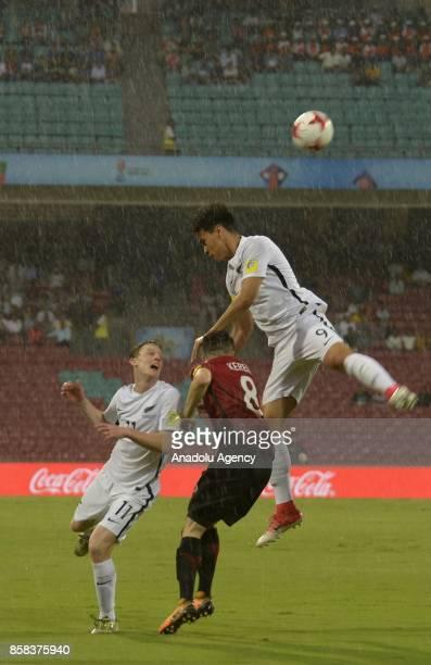 Kerem Atakan Kesgin of Turkey U17 in action against Matthew Conroy and Max Mata of New Zealand U17 during the FIFA U17 World Cup India 2017 football...