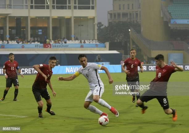 Kerem Atakan Kesgin of Turkey U17 in action against Max Mata of New Zealand U17 during the FIFA U17 World Cup India 2017 football match between...