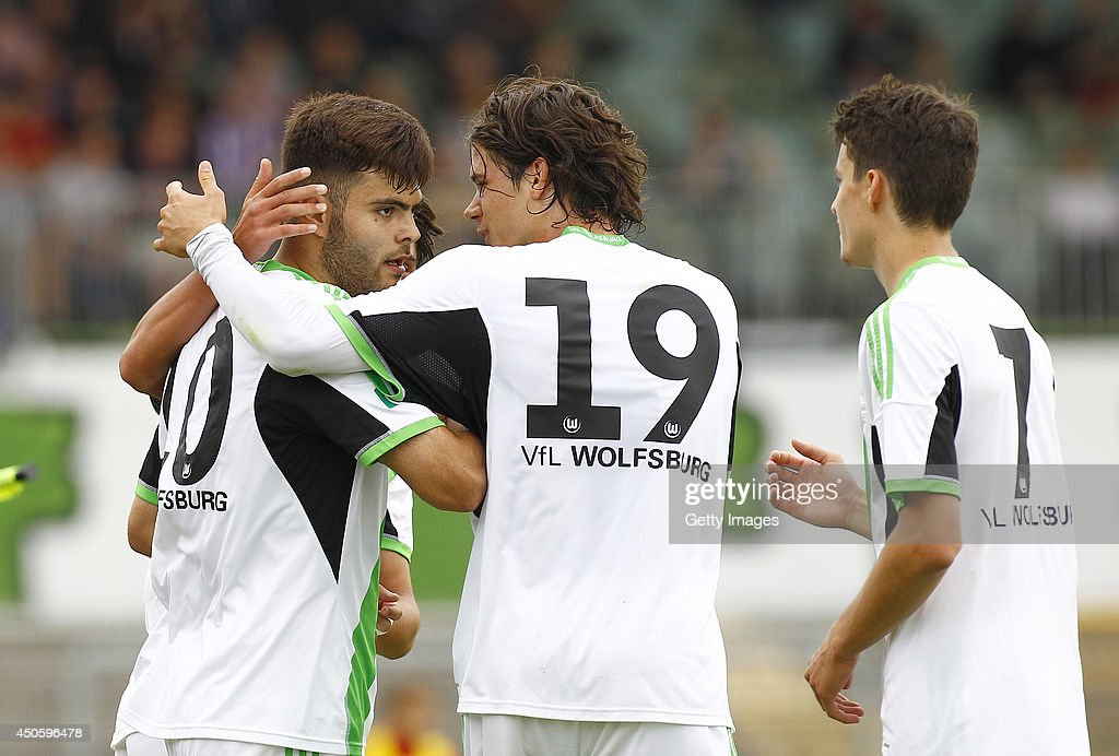 Kerem Buelbuel of Wolfsburg celebrates with teammates Oskar Zawada and Sebastian Stolze after scoring 2:1 during the A Juniors Bundesliga Semi Final between U19 VfL Wolfsburg and U19 Hannover 96 at Stadion am Elsterweg on June 14, 2014 in Wolfsburg, Germany.
