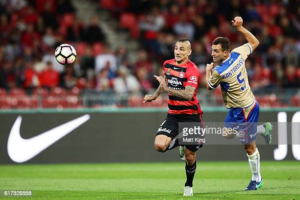Kerem Bulut of the Wanderers is challenged by Ben Kantarovski of the Jets during the round three ALeague match between the Western Sydney Wanderers...