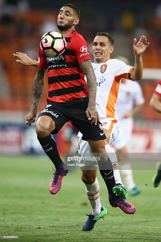 Kerem Bulut of the Wanderers is fouled by Jade North of the Roar during the round eight A-League match between the Western Sydney Wanderers and the Brisbane Roar at Spotless Stadium on November 25, 2016 in Sydney, Australia.