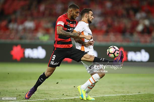 Kerem Bulut of the Wanderers misses a chance in front of goal under pressure from Brett Holman of the Roar during the round eight ALeague match...