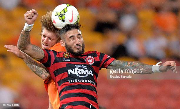 Kerem Bulut of the Western Sydney Wanderers and Luke Brattan of the Roar challenge for the ball during the round 21 ALeague match between Brisbane...