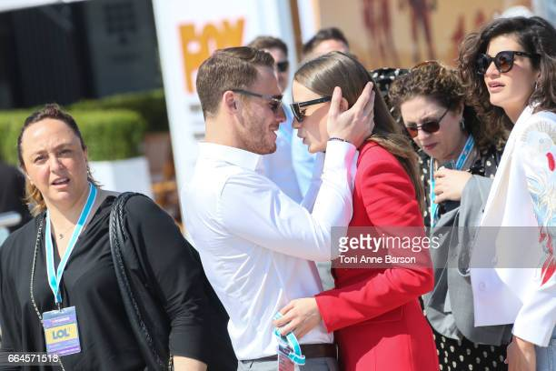 Kerem Bursin with Seranay Sarikaya after 'Heart Of The City' Photocall During MIPTV 2017 on April 3 2017 in Cannes France