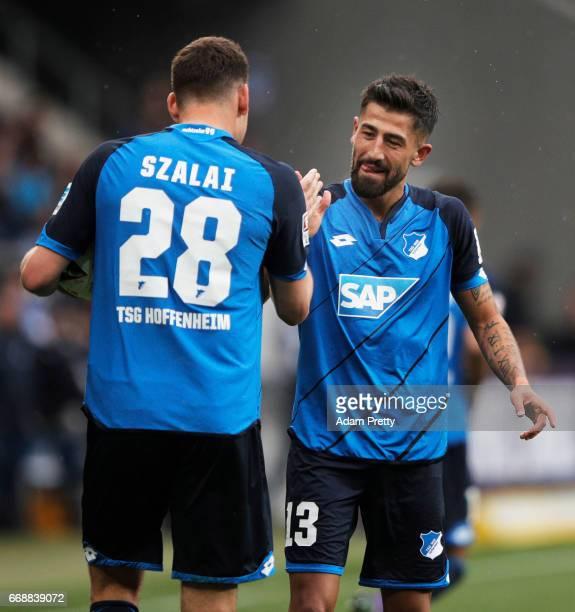Kerem Demirbay of 1899 Hoffenheim celebrates with Adam Szalai after scoring his first goal during the Bundesliga match between TSG 1899 Hoffenheim...