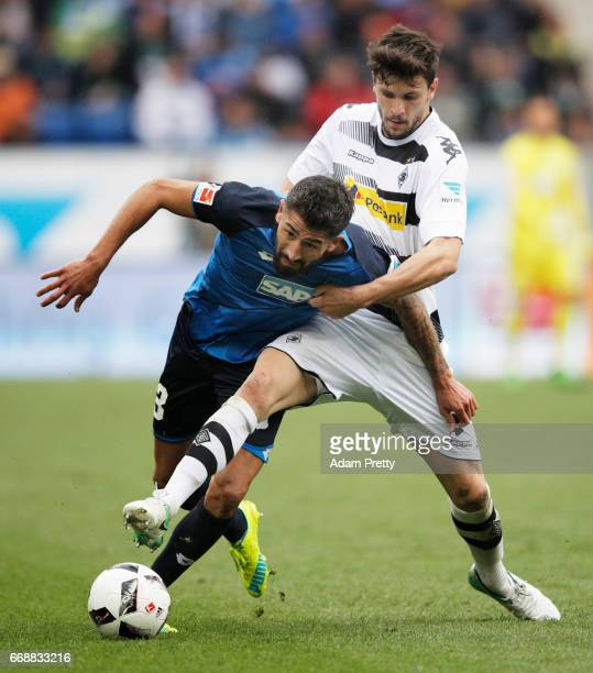 Kerem Demirbay of 1899 Hoffenheim is challenged by Tobias Strobl of Borussia Moenchengladbach during the Bundesliga match between TSG 1899 Hoffenheim...