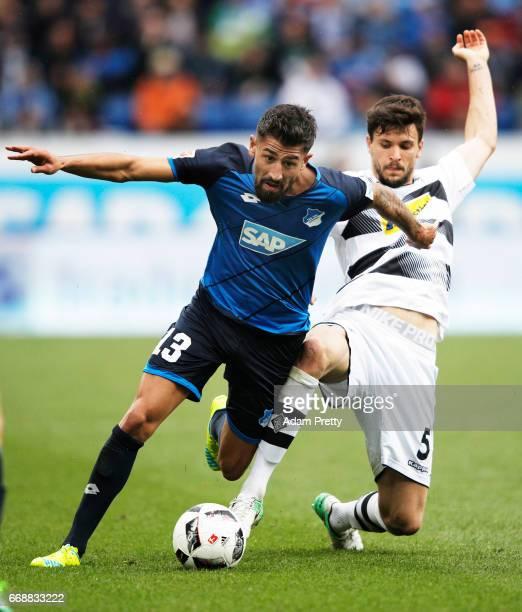 Kerem Demirbay of 1899 Hoffenheim is challenged by Tobias Strobl of Borussia Moenchengladbach during the Bundesliga match between TSG 1899 Hoffenheim...