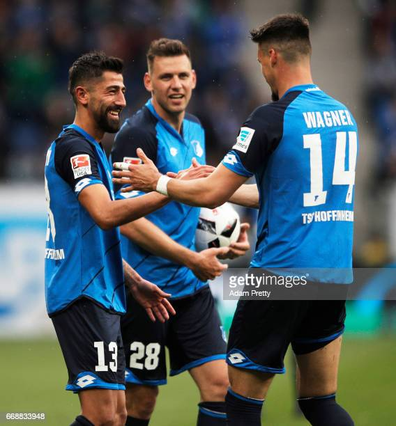 Kerem Demirbay of 1899 Hoffenheim is congratulated after scoring during the Bundesliga match between TSG 1899 Hoffenheim and Borussia...