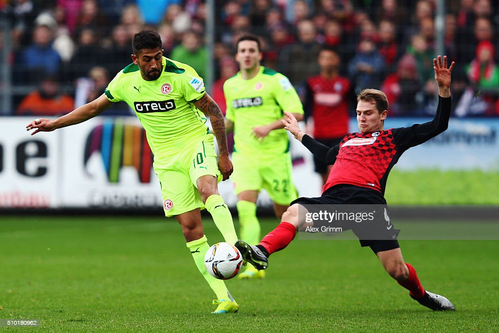 Kerem Demirbay (L) of Duesseldorf is challenged by Immanuel Hoehn of Freiburg during the Second Bundesliga match between SC Freiburg and Fortuna Duesseldorf at Schwarzwald-Stadion on February 14, 2016 in Freiburg im Breisgau, Germany.