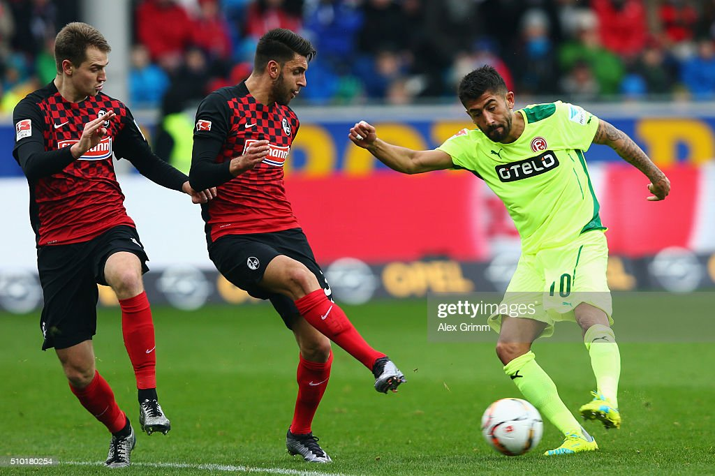 Kerem Demirbay of Duesseldorf is challenged by Vincenzo Grifo and Immanuel Hoehn (R-L) of Freiburg during the Second Bundesliga match between SC Freiburg and Fortuna Duesseldorf at Schwarzwald-Stadion on February 14, 2016 in Freiburg im Breisgau, Germany.