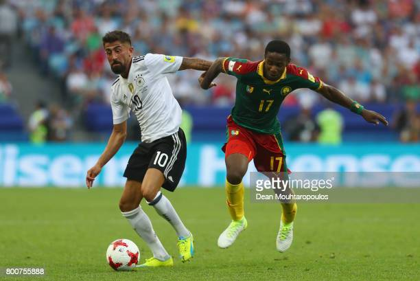 Kerem Demirbay of Germany and Amaud Djoum of Cameroon battle for possession during the FIFA Confederations Cup Russia 2017 Group B match between...