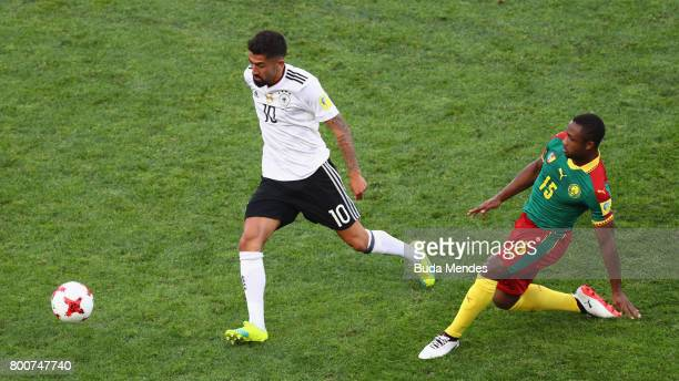 Kerem Demirbay of Germany puts pressure on Sebastien Siani of Cameroon during the FIFA Confederations Cup Russia 2017 Group B match between Germany...