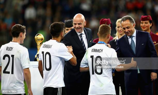 Kerem Demirbay of Germany shakes hands with FIFA President Ganni Infantino at the award ceremony after the FIFA Confederations Cup Russia 2017 Final...