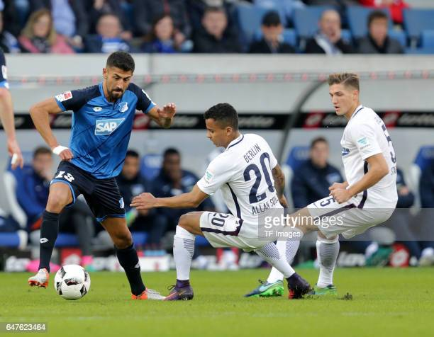 Kerem Demirbay of Hoffenheim and Allan of Berlin and Niklas Stark of Berlin and battle for the ball during the Bundesliga match between TSG 1899...