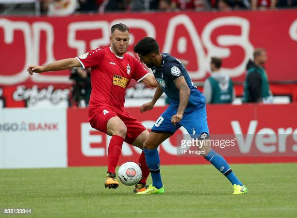 Kerem Demirbay of Hoffenheim and Berkay Tolga Dabanli of Erfurt battle for the ball during the DFB Cup first round match between RotWeiss Erfurt and...