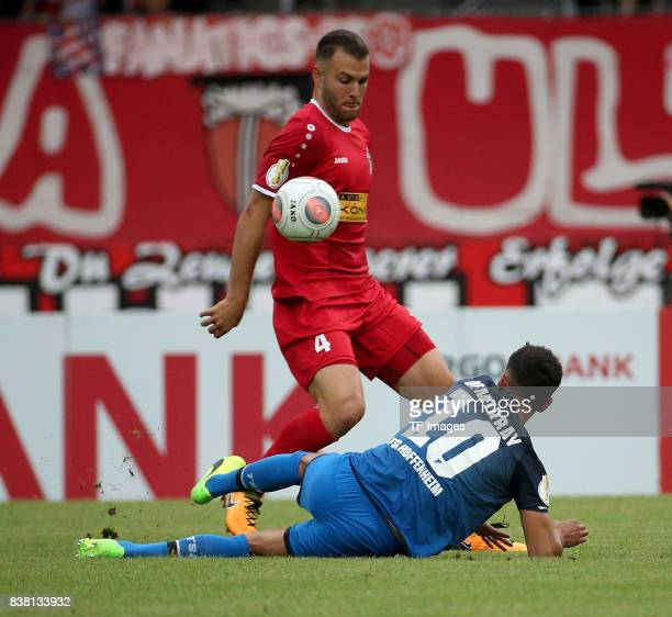 Kerem Demirbay of Hoffenheim and Berkay Tolga Dabanli of Erfurt controls the ball during the DFB Cup first round match between RotWeiss Erfurt and...