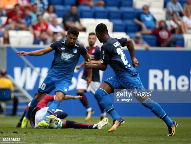 Kerem Demirbay of Hoffenheim and Erick Pulgar of Bologna and Serge Gnabry of Hoffenheim battle for the ball during the preseason friendly match...