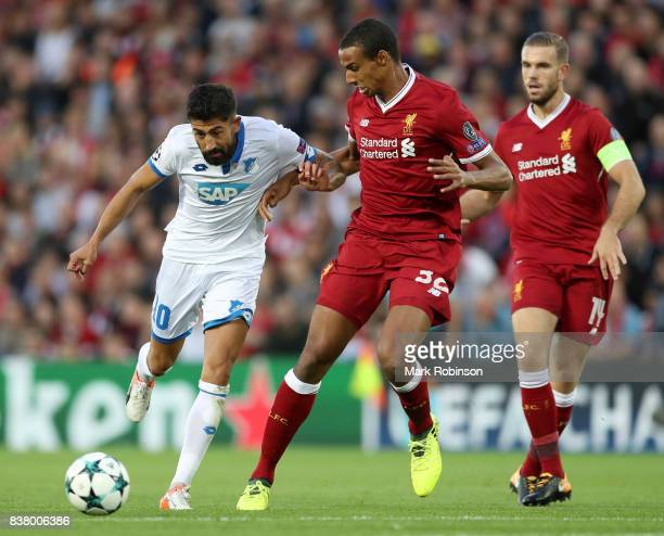 Kerem Demirbay of Hoffenheim and Joel Matip of Liverpool battle for possession during the UEFA Champions League Qualifying PlayOffs round second leg...