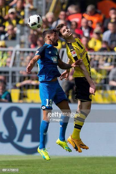 Kerem Demirbay of Hoffenheim and Julian Weigl of Dortmund battle for the ball during the Bundesliga match between Borussia Dortmund and TSG 1899...
