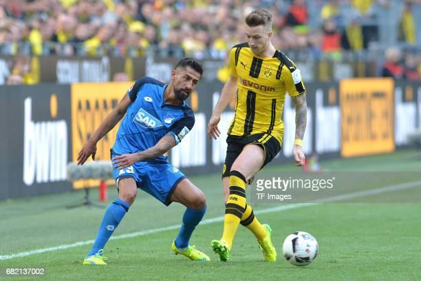 Kerem Demirbay of Hoffenheim and Marco Reus of Dortmund battle for the ball during the Bundesliga match between Borussia Dortmund and TSG 1899...
