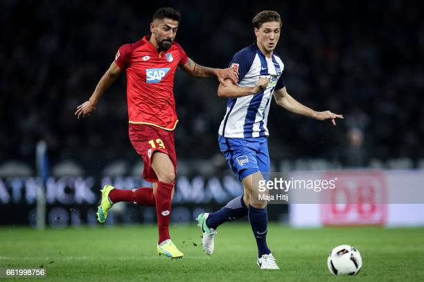 Kerem Demirbay of Hoffenheim and Niklas Stark of Berlin battle for the ball during the Bundesliga match between Hertha BSC and TSG 1899 Hoffenheim at...