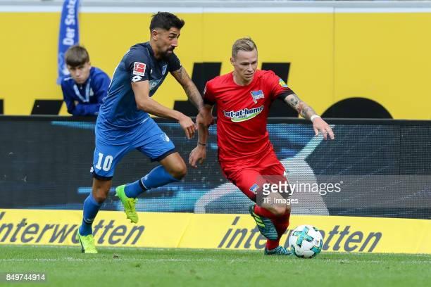 Kerem Demirbay of Hoffenheim and Ondrej Duda of Berlin battle for the ball during the Bundesliga match between TSG 1899 Hoffenheim and Hertha BSC at...