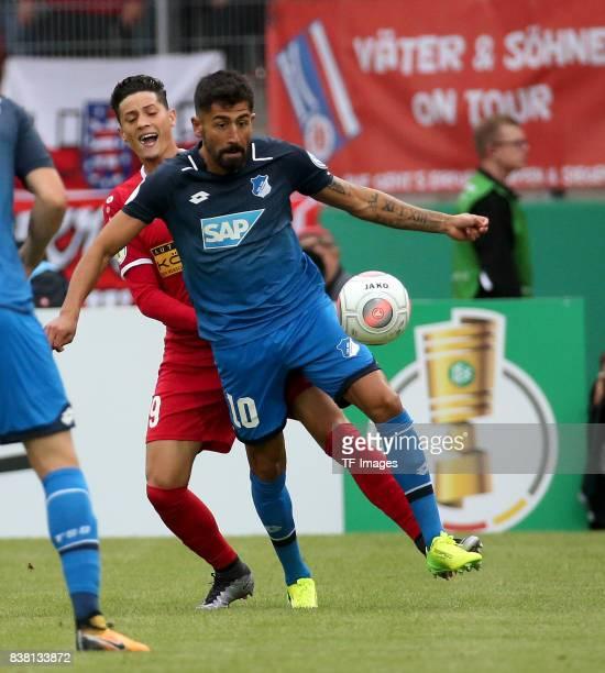 Kerem Demirbay of Hoffenheim and Samir Benamar of Erfurt battle for the ball during the DFB Cup first round match between RotWeiss Erfurt and TSG...