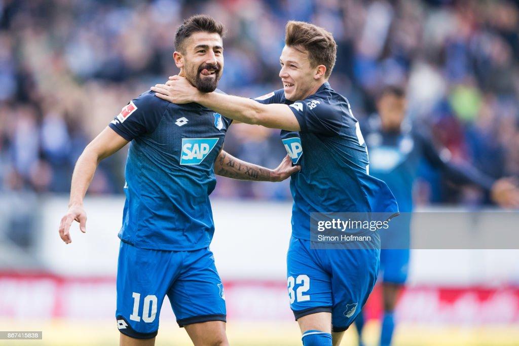 Kerem Demirbay of Hoffenheim celebrates his team's first goal with team mate Dennis Geiger during the Bundesliga match between TSG 1899 Hoffenheim and Borussia Moenchengladbach at Wirsol Rhein-Neckar-Arena on October 28, 2017 in Sinsheim, Germany.