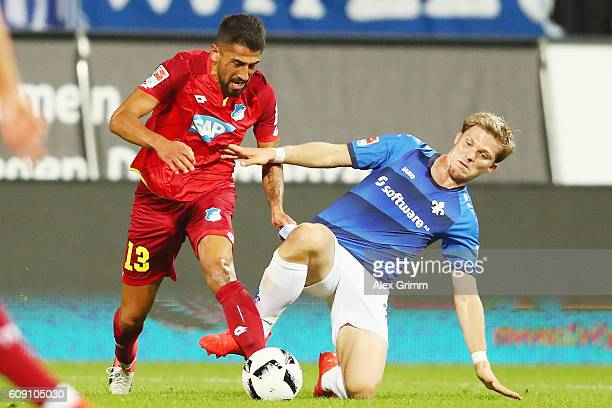 Kerem Demirbay of Hoffenheim is challenged by Florian Jungwirth of Darmstadt during the Bundesliga match between SV Darmstadt 98 and TSG 1899...