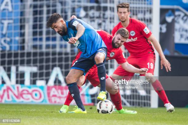 Kerem Demirbay of Hoffenheim is challenged by Marc Stendera of Frankfurt during the Bundesliga match between TSG 1899 Hoffenheim and Eintracht...