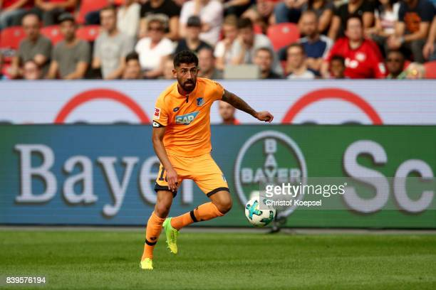 Kerem Demirbay of Hoffenheim runs with the ball during the Bundesliga match between Bayer 04 Leverkusen and TSG 1899 Hoffenheim at BayArena on August...
