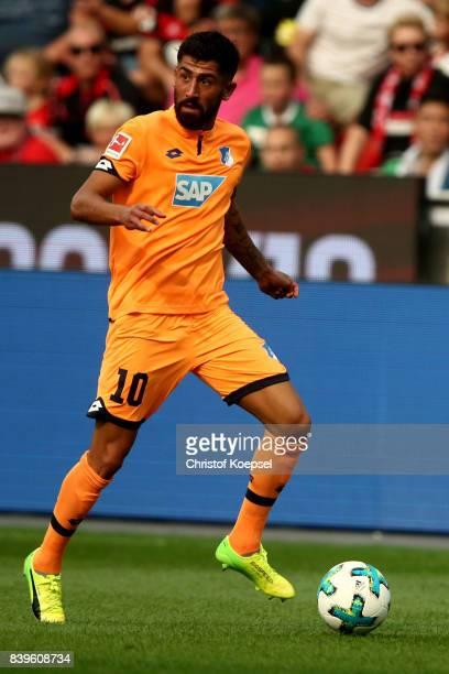 Kerem Demirbay of Hoffenheim runs with the ball the Bundesliga match between Bayer 04 Leverkusen and TSG 1899 Hoffenheim at BayArena on August 26...
