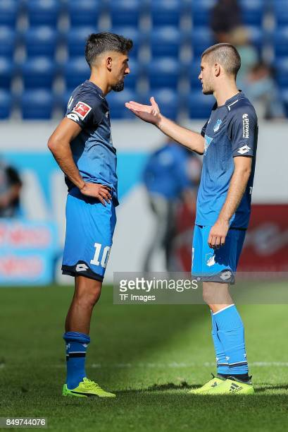 Kerem Demirbay of Hoffenheim speak with Andrej Kramaric of Hoffenheim during the Bundesliga match between TSG 1899 Hoffenheim and Hertha BSC at...