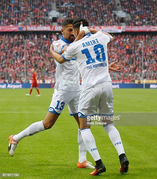 Kerem Demirbay of TSG Hoffenheim celebrates with team mate Nadiem Amiri of TSG Hoffenheim after scoring his team's first goal during the Bundesliga...