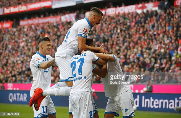 Kerem Demirbay of TSG Hoffenheim celebrates with team mates after scoring his team's first goal during the Bundesliga match between Bayern Muenchen...