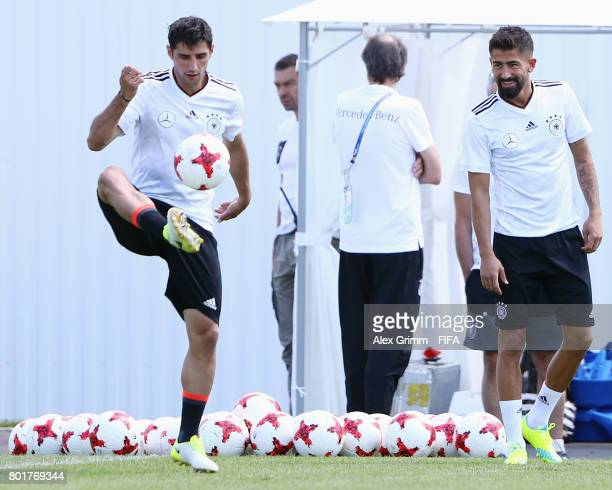 Kerem Demirbay watches Lars Stindl juggle with the ball during a Germany training session at Sotchi Parc Arena ahead of their FIFA Confederations Cup...