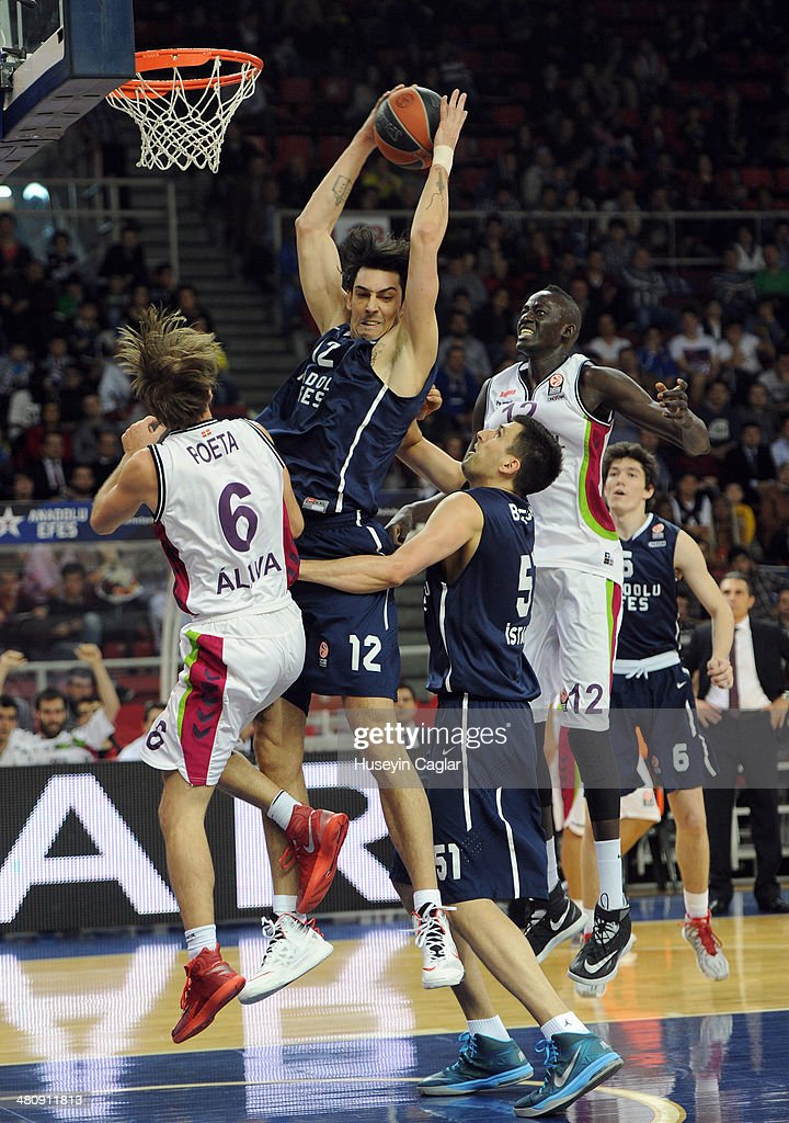 Kerem Gonlum #12 of Anadolu Efes Istanbul competes with Giuseppe Poeta #6 of Laboral Kutxa Vitoria in action during the 20132014 Turkish Airlines...