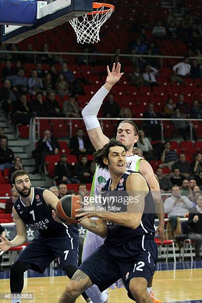Kerem Gonlum of Anadolu Efes competes with Vladimir Stimac of Unicaja Malaga during the 20132014 Turkish Airlines Euroleague Top 16 Date 2 game...