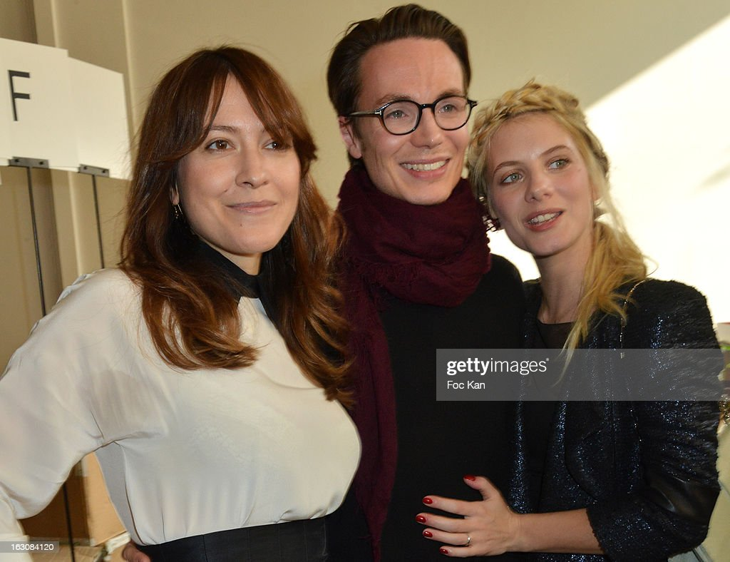 Keren Ann, Maxime Simoens and <a gi-track='captionPersonalityLinkClicked' href=/galleries/search?phrase=Melanie+Laurent&family=editorial&specificpeople=2721978 ng-click='$event.stopPropagation()'>Melanie Laurent</a> attend the Maxime Simoens - Front Row - PFW F/W 2013 at Foyer des Lyceennes Dr Blanche on March 3rd, 2013 in Paris, France.