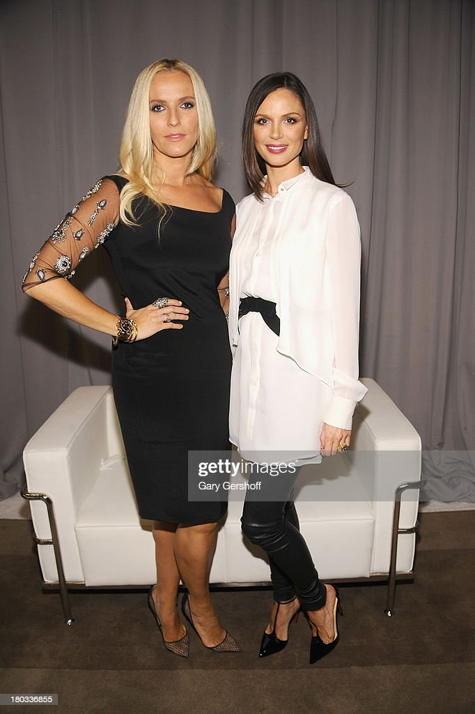 Keren Craig (L) and Georgina Chapman pose backstage at the Marchesa show during Spring 2014 Mercedes-Benz Fashion Week at New York Public Library on September 11, 2013 in New York City.