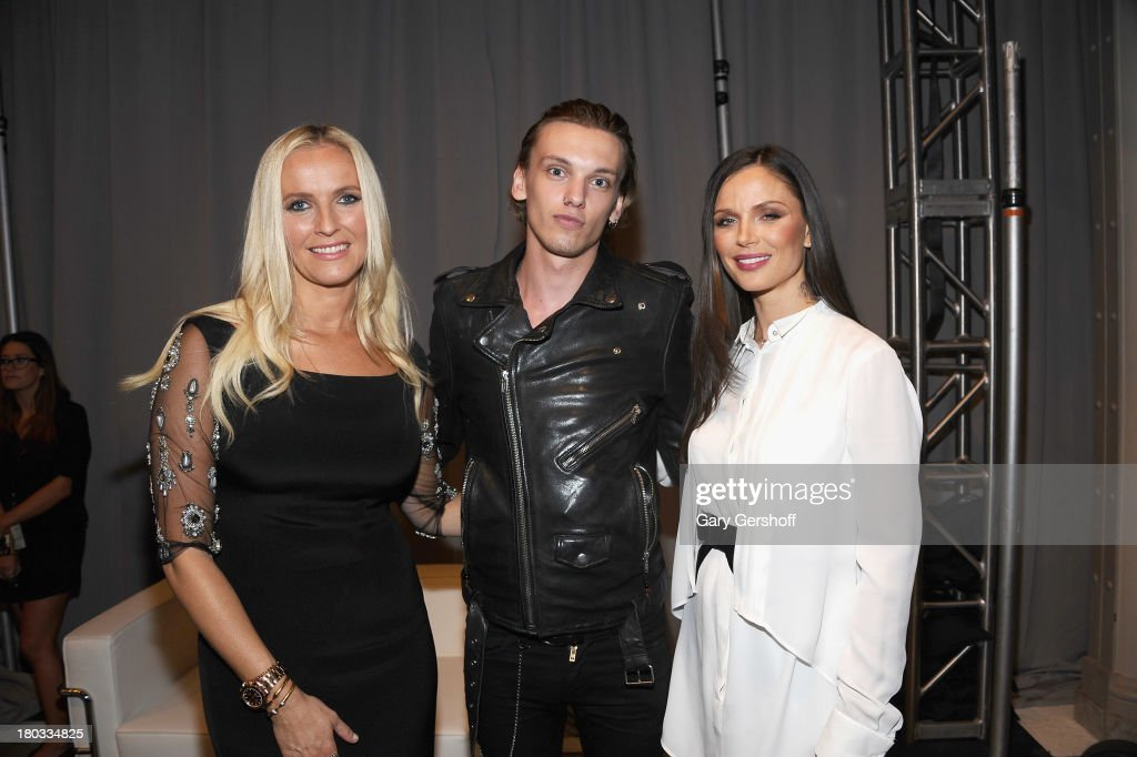 Keren Craig, Jamie Campbell Bower and Georgina Chapman attend the Marchesa show during Spring 2014 Mercedes-Benz Fashion Week at New York Public Library on September 11, 2013 in New York City.