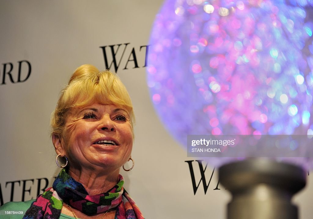 Keri Clark (L) and a model of the Times Square New Year's Eve ball on December 27, 2012 in New York at a press conference presenting the new Waterford Crystal triangle design to be placed on the ball. Keri is the widow of Dick Clark, longetime televison host of the Times Square New Year's Eve ball drop. AFP PHOTO/Stan HONDA