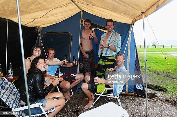Keri Toni Simon Paddy Wade and Scott of Rotorua huddle in their tent as rain pours down at the Mount camp ground on December 31 2011 in Mount...