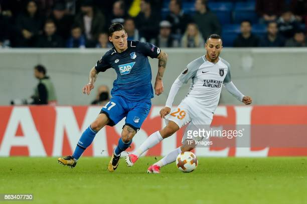 Kerim Frei of Istanbul Basaksehir and Steven Zuber of Hoffenheim battle for the ball during the UEFA Europa League Group C match between 1899...