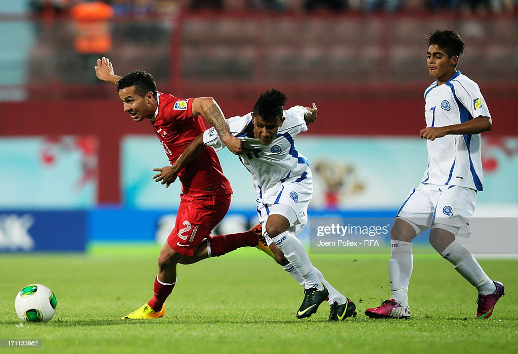 Kerim Koyunlu (L) of Turkey and Maikon Orellana of El Salvador compete for the ball during the FIFA U-20 World Cup Group C match between Turkey and El Salvador at Huseyin Avni Aker Stadium on June 22, 2013 in Trabzon, Turkey.