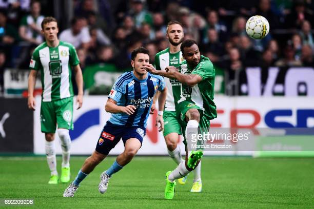 Kerim Mrbati of Djurgardens IF and SergeJunior Martinsson Ngouali of Hammarby IF competes for the ball during the Allsvenskan match between Hammarby...