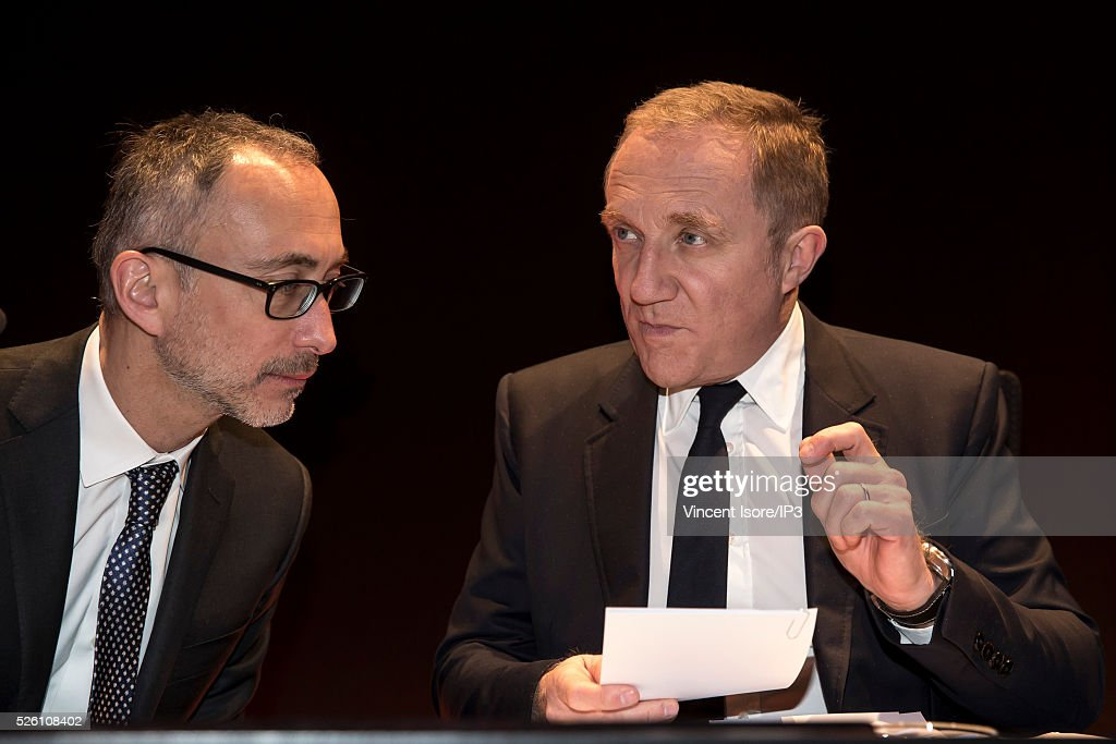 Kering Legal director Eric Sandrin (L) speaks with Kering CEO Francois Henri Pinault (R) during the general shareholders meeting of the French luxury and sports clothing group Kering on April 29, 2016 in Paris, France. Kering suffered by low Gucci sales and is the last of the CAC 40 (PARIS STOCK INDEX).