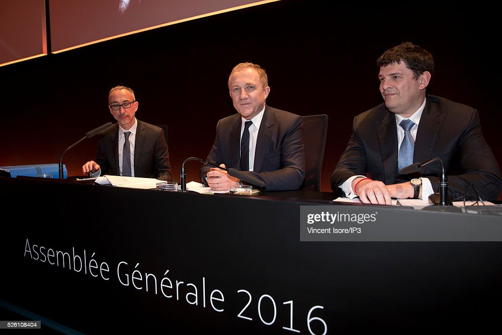 Kering Legal director Eric Sandrin (L) speaks with Kering CEO Francois Henri Pinault (C), Kering CFO Jean Francois Palus (R) during the general shareholders meeting of the French luxury and sports clothing group Kering on April 29, 2016 in Paris, France. Kering suffered by low Gucci sales and is the last of the CAC 40 (PARIS STOCK INDEX).
